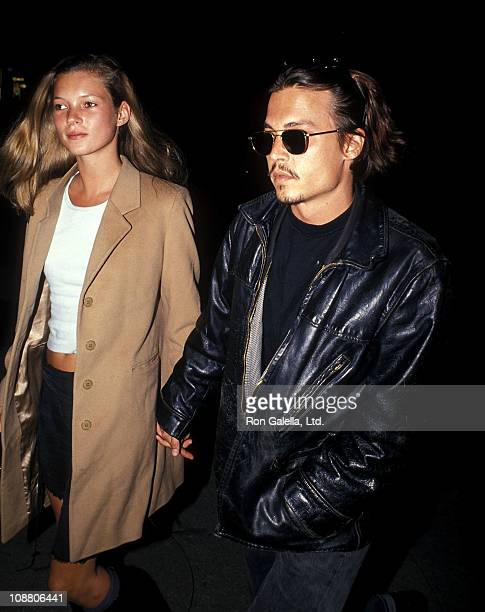 Model Kate Moss and actor Johnny Depp attend the 'Serial Mom' New York City Premiere on April 4 1994 at Loews Screening Room in New York City