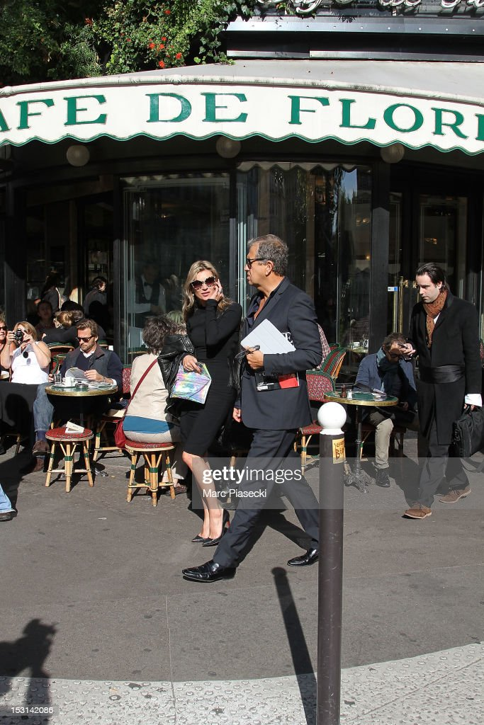 Model Kate Moss and photographer Mario Testino are seen leaving the 'Cafe de Flore' on October 1, 2012 in Paris, France.