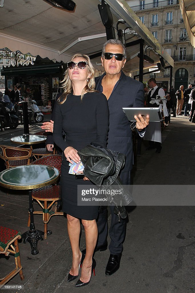 Model Kate Moss and photographer Mario Testino arrive at 'Cafe de Flore' on October 1, 2012 in Paris, France.