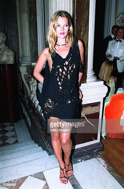 Model Kate Moss attends a fashion show organised by Fawaz Grossi showcasing Galliano designs and Maison de Grisogne jewellery June 18 2003 in Paris...
