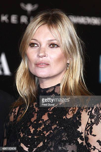 Model Kate Moss attends a private view for the 'Alexander McQueen Savage Beauty' exhibition at Victoria Albert Museum on March 12 2015 in London...