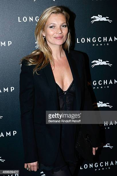 Model Kate Moss attends the Longchamp Elysees 'Lights On Party' Boutique Launch on December 4 2014 in Paris France