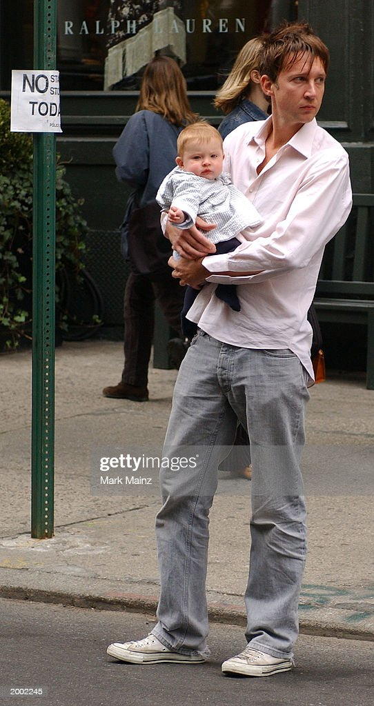 Model Kate Moss' boyfriend Jefferson Hack walks with their baby daughter Lola in the SoHo neighborhood May 15, 2003 in New York City.