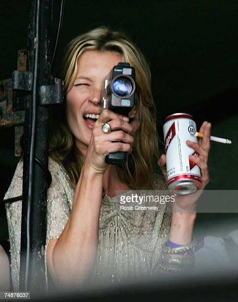 Model Kate Moss films boyfriend Pete Doherty on the Park acoustic stage on the second day of the Glastonbury Festival at Worthy Farm Pilton near...
