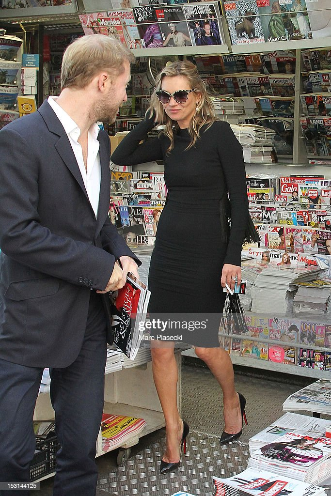 Model <a gi-track='captionPersonalityLinkClicked' href=/galleries/search?phrase=Kate+Moss&family=editorial&specificpeople=201830 ng-click='$event.stopPropagation()'>Kate Moss</a> is seen near the 'Cafe de Flore' on October 1, 2012 in Paris, France.