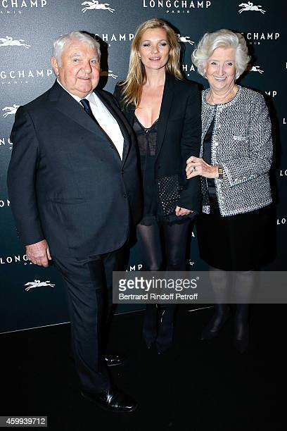 Model Kate Moss standing between owners of Longchamp Michele and Philippe Cassegrain attend the Longchamp Elysees 'Lights On Party' Boutique Launch...