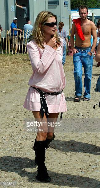 Model Kate Moss strolling around The Glastonbury Festival 2003 on June 27 2003 at Pilton in Shepton Mallett Glastonbury in England