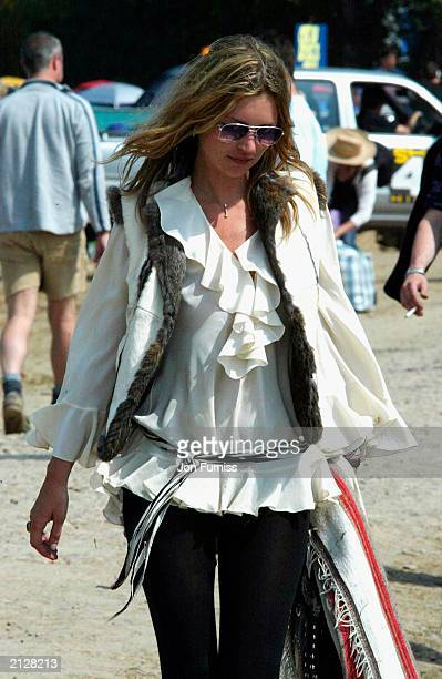 Model Kate Moss strolling around The Glastonbury Festival 2003 on June 27 2003 at Pilton in Shepton Mallett Glastonbury in England