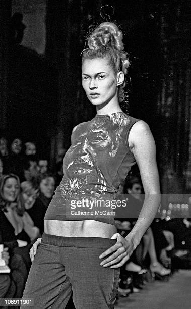 Model Kate Moss walks the runway at British fashion designer Alexander McQueen's first New York fashion show at a former synagogue on Norfolk Street...