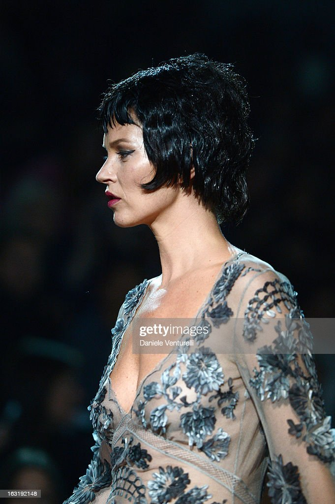 A model Kate Moss walks the runway during Louis Vuitton Fall/Winter 2013 Ready-to-Wear show as part of Paris Fashion Week on March 6, 2013 in Paris, France.