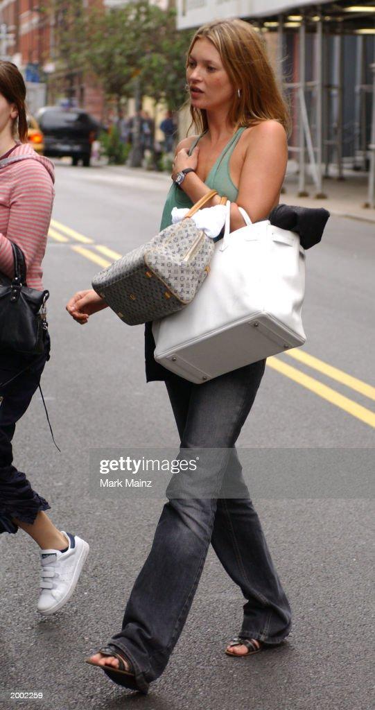 Model Kate Moss walks through the SoHo neighborhood May 15, 2003 in New York City.