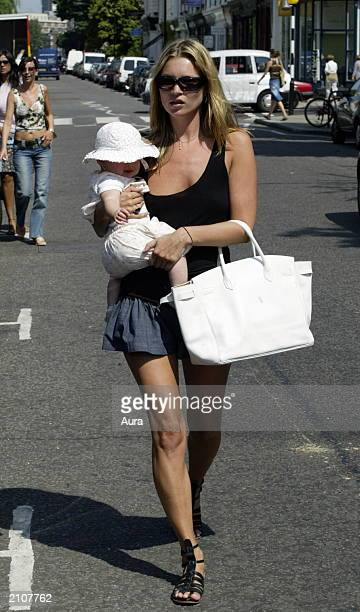 Model Kate Moss walks with her baby daughter Lola in Notting Hill June 24 2003 in West London