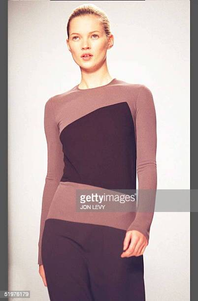 Model Kate Moss wears a twotone long sleeve dress in the Calvin Klein fall 1996 fashion show 01 April in New York The fall fashion shows continue...