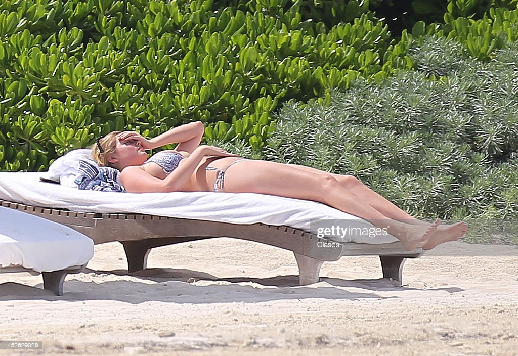 Model <a gi-track='captionPersonalityLinkClicked' href=/galleries/search?phrase=Kate+Upton&family=editorial&specificpeople=7488546 ng-click='$event.stopPropagation()'>Kate Upton</a> and her boyfriend Justin Verlander relax in the sun in Cancun on July 14, 2014 in Cancun, Mexico.
