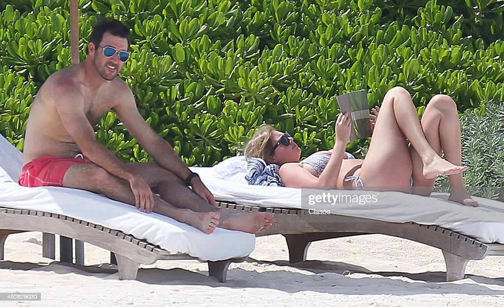 Model <a gi-track='captionPersonalityLinkClicked' href=/galleries/search?phrase=Kate+Upton&family=editorial&specificpeople=7488546 ng-click='$event.stopPropagation()'>Kate Upton</a> and her boyfriend <a gi-track='captionPersonalityLinkClicked' href=/galleries/search?phrase=Justin+Verlander&family=editorial&specificpeople=556723 ng-click='$event.stopPropagation()'>Justin Verlander</a> relax in the sun in Cancun on July 14, 2014 in Cancun, Mexico.
