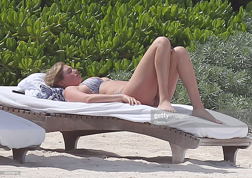 Model Kate Upton and her boyfriend Justin Verlander relax in the sun in Cancun on July 14, 2014 in Cancun, Mexico.