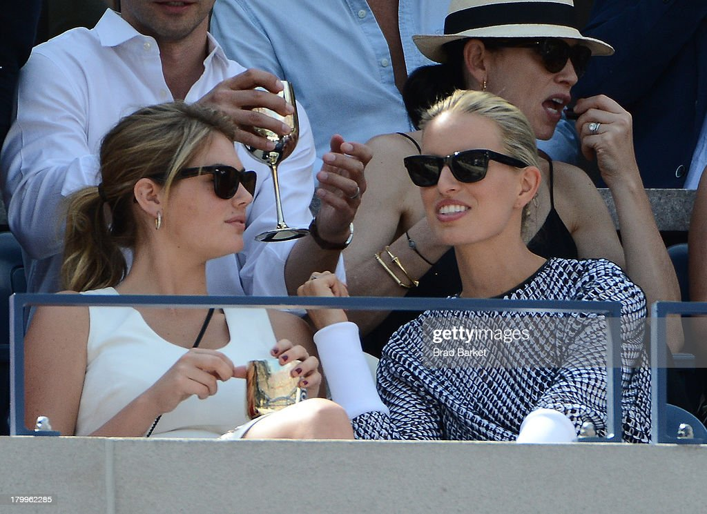 Model Kate Upton(L) and Karolina Kurkova attend The Moet & Chandon Suite at USTA Billie Jean King National Tennis Center on September 7, 2013 in New York City.