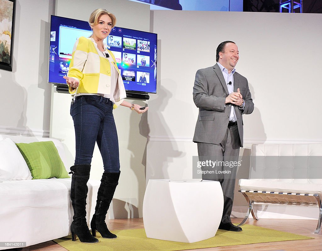 Model Kate Upton and Samsung Electronics America Executive Vice President Joe Stinziano attend Samsung's 2013 Television Line Launch Event at Museum Of American Finance on March 20, 2013 in New York City.