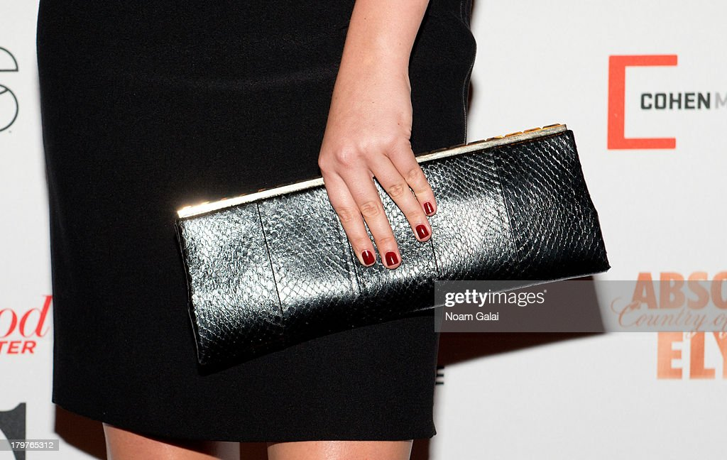 Model Kate Upton (purse detail) attends 'Mademoiselle C' New York Premiere at Florence Gould Hall on September 6, 2013 in New York City.
