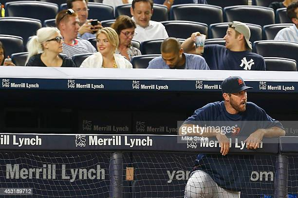 Model Kate Upton attends the game against the New York Yankees as Justin Verlander of the Detroit Tigers looks on from the bench at Yankee Stadium on...