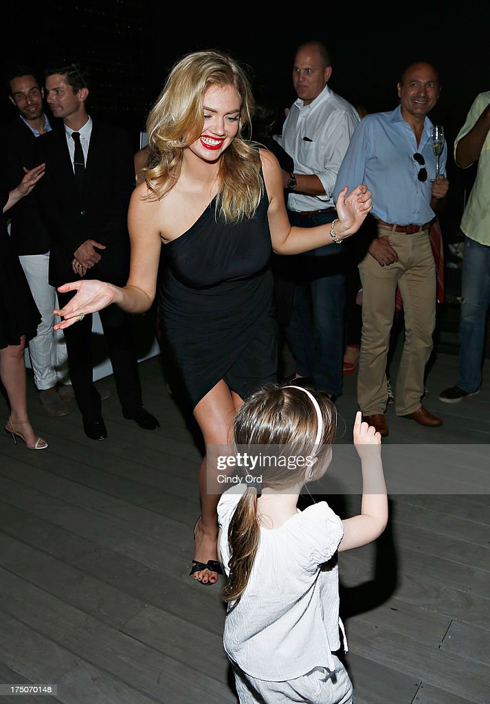 Model <a gi-track='captionPersonalityLinkClicked' href=/galleries/search?phrase=Kate+Upton&family=editorial&specificpeople=7488546 ng-click='$event.stopPropagation()'>Kate Upton</a> dances at the David Yurman Annual Rooftop Soiree at David Yurman Rooftop on July 30, 2013 in New York City.