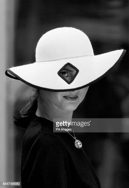 Model Katherine Pearce keeps an eye out for high fashions as she wears a 'diamond eye' hat priced at 166 complemented by a 16m yellow diamond...