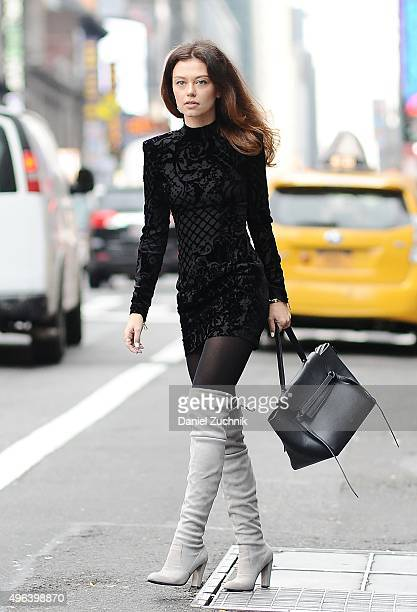 Model Katy Yanok is seen wearing a Balmain x HM silk blend velvet dress Stuart Weitzman shoes and a Celine bag on November 9 2015 in New York City