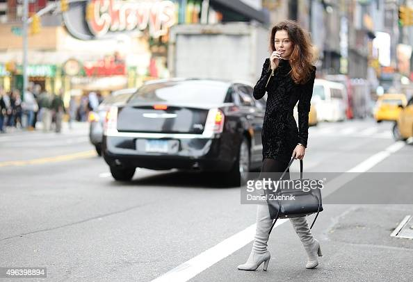 Model Katy Yanok is seen wearing a Balmain x HM silk blend velvet dress Stuart Weitzman shoes and a Celine bag on November 9 2015 in New York City