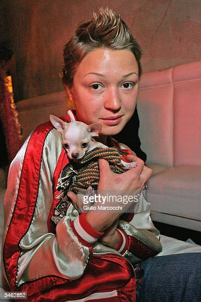 Model Katya Evtushenko with her dog Angel attend the GQ Lounge Los Angeles Celebration of 'The Art Of Elysium' afterparty at the GQ Lounge@The...