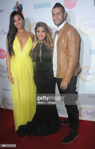 Model KD Aubert designer Sai Suman and fighter Mehdi Baghdad at Sai Suman's Official Hollywood Runway Fashion Show held at Sofitel Hotel on April 11...