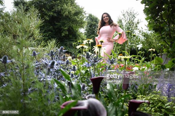Model Kelly Brook poses for photographs at the 'On the Edge The Centre for Mental Health Garden' on the press preview day of the Hampton Court Palace...