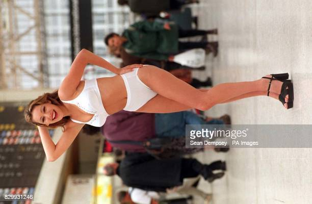 Model Kelly Brook poses for the media wearing Playtex underwear during a photocall at Waterloo Station in London today to launch the company's new...