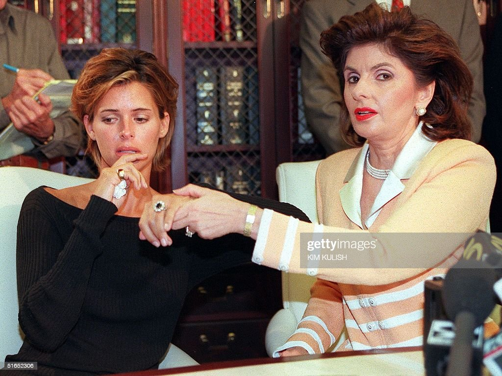 US model Kelly Fisher, 31, (L) and her attorney Gloria Allred show off the large sapphire and diamond engagement ring given to her by former Egyptian fiancee Dodi al-Fayed. They announced the filing of a breach of contract suit against al-Fayed during a 14 August press conference in Los Angeles. Dodi al-Fayed has been linked to Princess Diana after the publication of a photo of Diana with him. Fisher gave up her modeling career in anticipation of her impending marriage to the Egyptian.