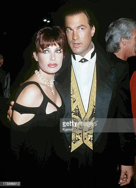 Model Kelly LeBrock and her husband actor Steven Seagal attending the premiere of 'Under Siege' on October 8 1992 at Mann Village Theater in Westwood...
