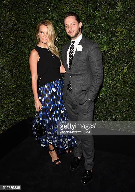Model Kelly Sawyer and writer Derek Blasberg attend the Charles Finch and Chanel PreOscar Awards Dinner at Madeo Restaurant on February 27 2016 in...