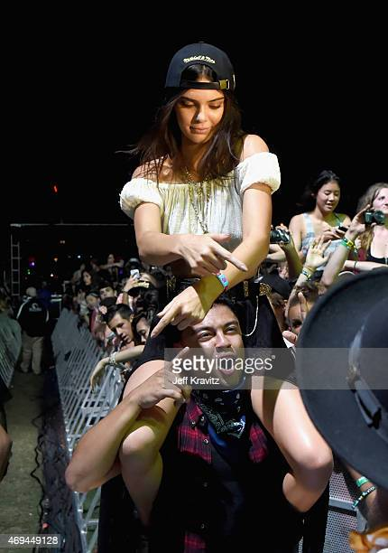 Model Kendall Jenner and Alfredo Flores in the audienceduring day 2 of the 2015 Coachella Valley Music Arts Festival at the Empire Polo Club on April...