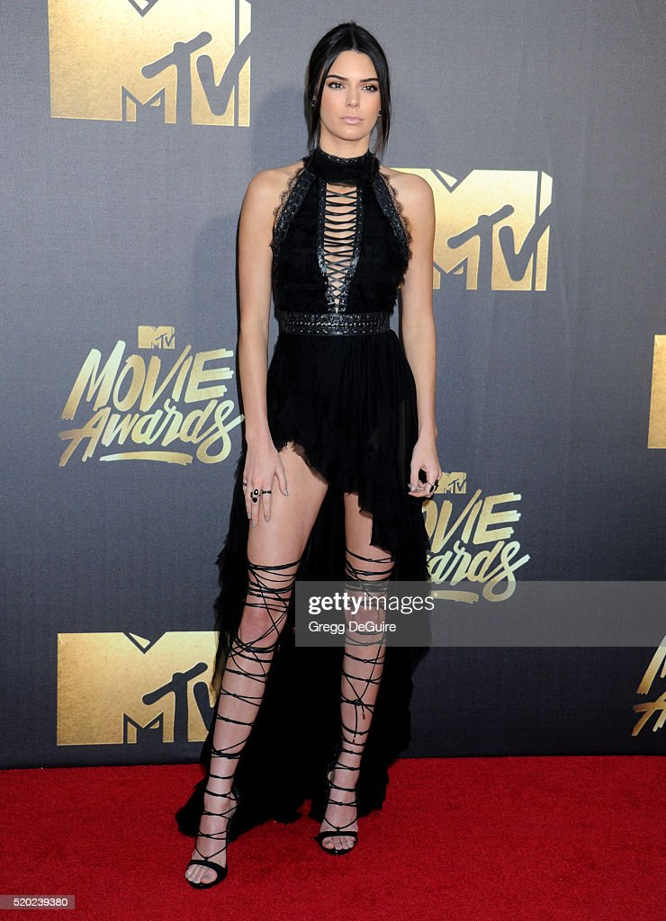 Model Kendall Jenner arrives at the 2016 MTV Movie Awards at Warner Bros Studios on April 9 2016 in Burbank California