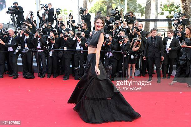 US model Kendall Jenner poses as she arrives for the screening of the film 'Youth' at the 68th Cannes Film Festival in Cannes southeastern France on...