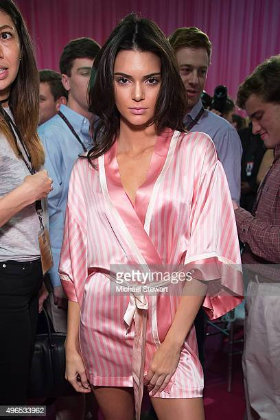 Model Kendall Jenner prepares backstage before the 2015 Victoria's Secret Fashion Show at Lexington Armory on November 10 2015 in New York City