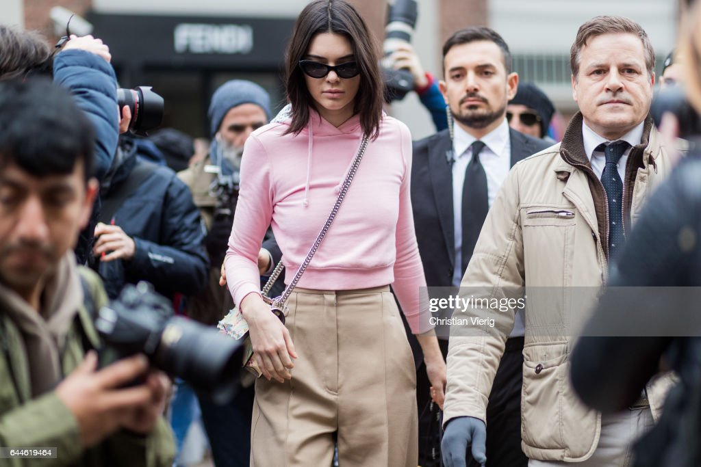 Model Kendall Jenner wearing a pink hoody outside Fendi during Milan Fashion Week Fall/Winter 2017/18 on February 23, 2017 in Milan, Italy.