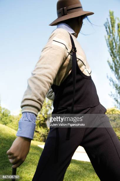 Model poses at a fashion shoot for Madame Figaro on June 22 2017 in EvianlesBains France Sweater shirt overalls hat PUBLISHED IMAGE CREDIT MUST READ...