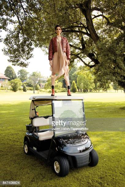 Model poses at a fashion shoot for Madame Figaro on June 22 2017 in EvianlesBains France Jacket and dress boots and golf bag PUBLISHED IMAGE CREDIT...