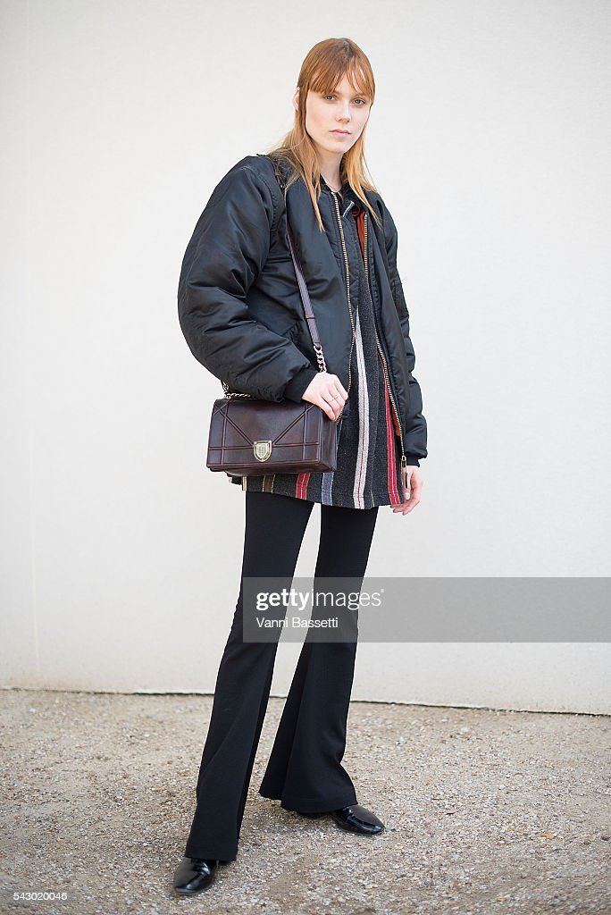Model Kiki Willems poses with a Dior bag after the Sacai show at the Jardin du Luxembourg during Paris Menswear Fashion Week SS17 on June 25, 2016 in Paris, France.