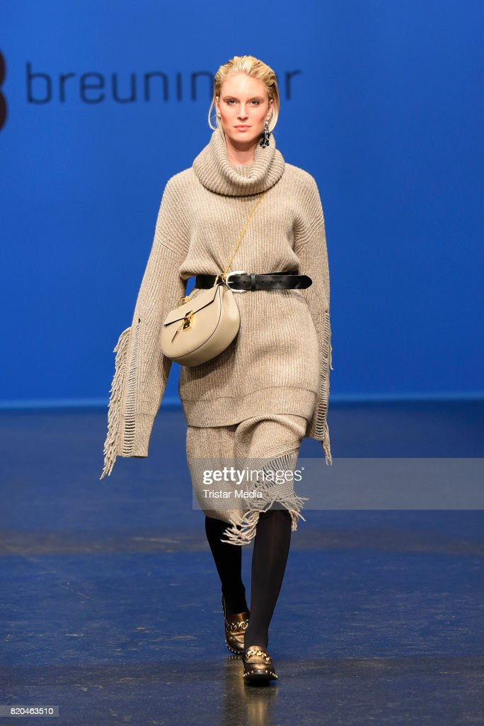 Model Kim Hnizdo walks the runway at the Breuninger show during Platform Fashion July 2017 at Areal Boehler on July 21, 2017 in Duesseldorf, Germany.