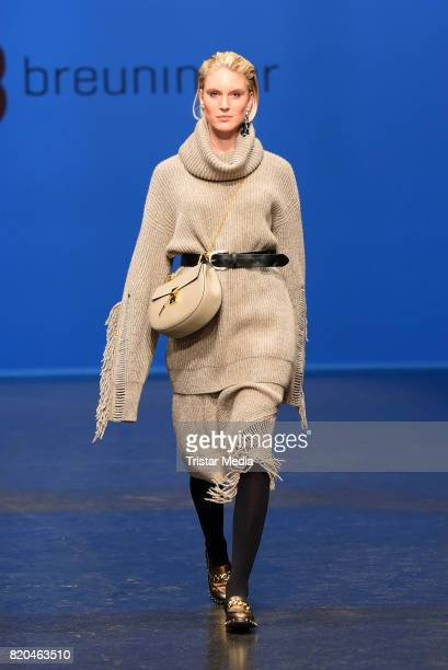 Model Kim Hnizdo walks the runway at the Breuninger show during Platform Fashion July 2017 at Areal Boehler on July 21 2017 in Duesseldorf Germany