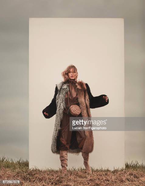 Model poses at a fashion shoot for Madame Figaro on September 12 2017 in Paris France Coat sweatsuit bag boots PUBLISHED IMAGE CREDIT MUST READ...
