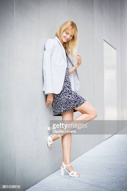 Model Kris Agapova wears a French Connection black and white dots dress French Connection grey jacket Zara white shoes and Mango accessories on June...