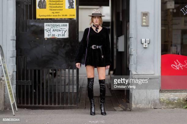 Model Kristine Ullebo wearing black overknees black belted velvet dress hat outside Vanessa Rudjord on August 24 2017 in Oslo Norway