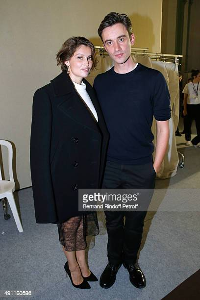 Model Laetitia Casta and Fashion designer Guillaume Henry pose after the Nina Ricci show as part of the Paris Fashion Week Womenswear Spring/Summer...
