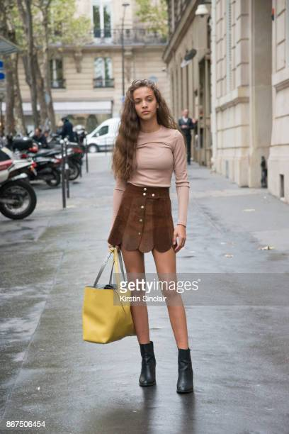Model Laiqah Omar wears an H and M skirt and top Zara bag and Topshop boots day 3 of Paris Womens Fashion Week Spring/Summer 2018 on September 28...